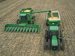 John Deere combine and tractor.