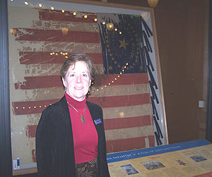 Laura Lee Ramirez in front of Iowa Battle Flag