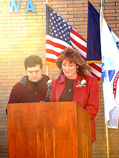 Geri Nisely, widow of Scott Nisely, and  her son Justin Nisely.