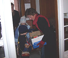 First Lady Mari Culver, daughter Claire, son John deliver Thanskgiving dinner to a Des Moines shelter