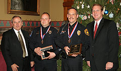 Public Safety Director Gene Meyer, Officers Todd Smith and Steve Klemas, Governor Culver