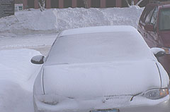 Snow covered car in Des Moines