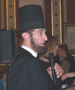 Stan De Haan portrays Abraham Lincoln