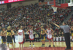 Players from Dunkerton and WCLT line up at the free-throw line in the state tournament