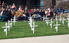Crosses signifying workers who died on the job at a ceremony in their honor.