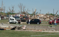 Survivors view destruction left by tornado that hit Parkersburg.