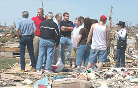 Iowa Senator Chuck Grassley (fourth from left) toured the destruction left by Sunday's tornado.