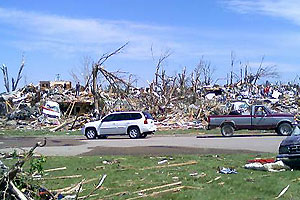 The storm-damaged Aplington-Parkersburg High School is seen in the upper left side of this photo.