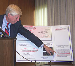 A-G Tom Miller points out letters sent from the Credit Card Protection Agency.