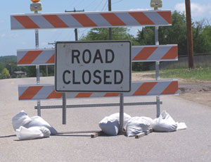 Road closed signs are common in Iowa with all the flooding.