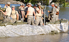 Iowa Guardmembers work on a sandbag levee in Ottumwa. (ING photo)