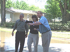 President Bush views flood damage in Iowa City with Mayor Reginia Bailey and Governor Culver.