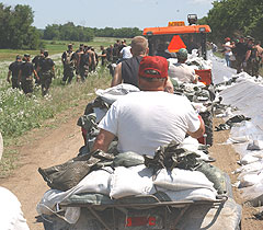 Iowa National Guard soldiers haul sandbags trying to save farmland near Kingston.