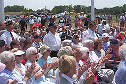 Iowa Navy veterans stand and are recognized during the dedication of the Iowa Veterans Cemetery.