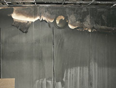Scorched wall after fire in UNI's Gilchrist Hall.