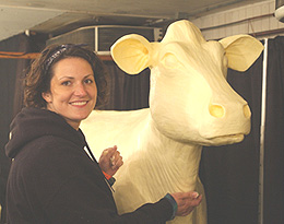 Sarah Pratt sculpts the butter cow at the Iowa State Fair.