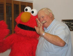 Elmo and Storm Lake Mayor John Kruse