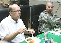 Representative Dave Loebsack (D), has dinner with Sgt. Scott Buss, a native of Hampton, Iowa at Camp Liberty Aug. 14, 2008.