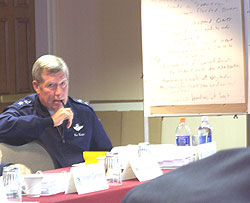 General Ron Dardis listens to discussion during Rebuild Iowa Commission meeting.