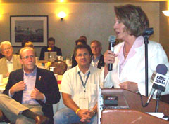 Iowa Congressmen Dave Loebsack and Bruce Braley listen to House Speaker Nancy Pelosi.