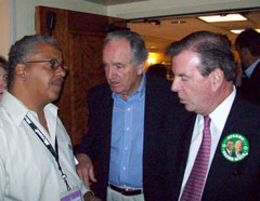 AFSCME leader Gerald McEntee and Iowa Senator Tom Harkin talk with delegate.