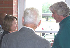 House Speaker Nancy Pelosi talks with Des Moines Public Works Director Bill Stowe and Congressman Leonard Boswell.