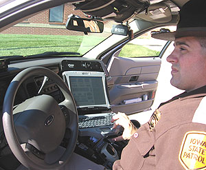 Trooper Marc Griggs in voice activated car.
