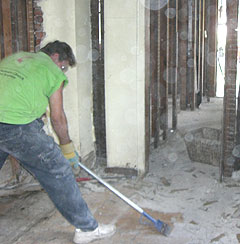 A volunteer works on a flooded home in Cedar Rapids.