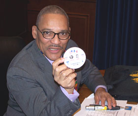 Slayton Thomas shows button from 1992 election.