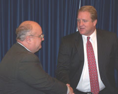 Elector Jon Heitland of Iowa Falls talks with Governor Culver.
