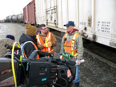 History Channel's Extreme Trains producer/director Dominic Stobart and the show's host Matt Bown (center) get a job briefing from Union Pacific switchman/brakeman Blake Benne in Council Bluffs, Iowa, rail yard.