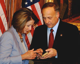 House Speaker Nancy Pelosi and Iowa Congressman Steve King examine King's Civil War era bible.