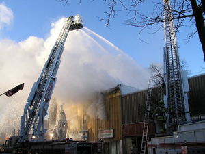 Firefighters spray water on downtown Boone fire.