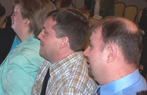 Gay couples listen to announcement of today's Supreme Court ruling.