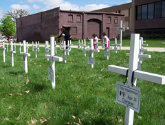 Crosses signify the 65 state employees who died on the job.