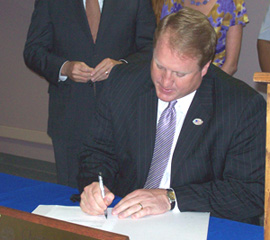 Govenror Culver signs health reform bill into law.