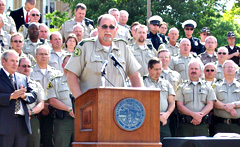Louisa County Sheriff Curt Braby talks at bill signing.