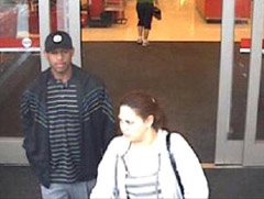 Surveillance photo of couple sought in central Iowa robberies.