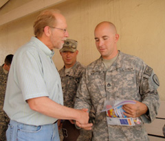 Congressman Dave Loebsack hands out care packages to soldiers.