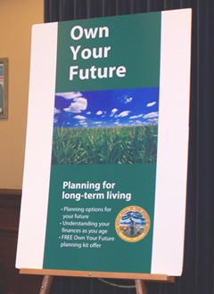 "Display touting ""Own Your Future"" program."
