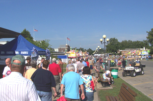 People walk along grand concourse of the Iowa State Fair.