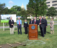 Utilities board chair Robert Berntsen and Governor Culver and other dignitaries break ground for board building.