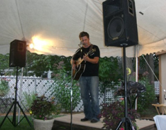 Chad Elliott performs at backyard concert.