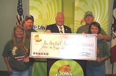 Rick Hamilton and Sharon Sulser of Chariton and Vickie and Terry Chambers of Columbia accept winnings from Lottery CEO Terry Rich.