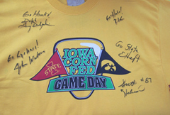 An autographed t-shirt touting the Cyclones, Hawkeyes and corn.