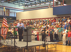 Congressman Boswell leads Pledge of Allegiance at town hall meeting.