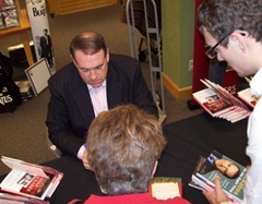 Mike Huckabee signs books.