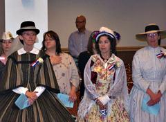 Women dressed in Civil War garb for Veterans Day event.