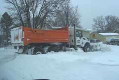 Des Moines snowplow stuck while trying to clear a side street.