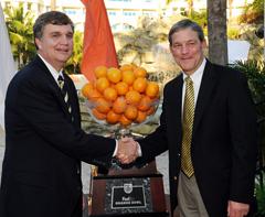 Coach Johnson, Coach Ferentz at an even prior to the Orange Bowl.